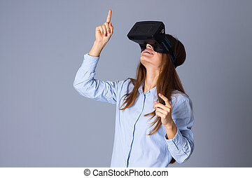 Woman using VR glasses - Young pretty woman in blue shirt...