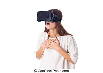 Woman using VR glasses - Amazed young woman in white shirt...