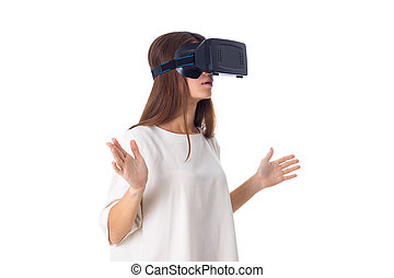 Woman using VR glasses - Young pretty woman in white shirt...