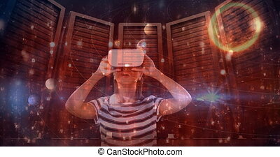 Woman using VR with constellation background - Digital ...