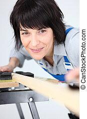 Woman using workbench