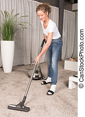 woman vacuum cleaning carpet