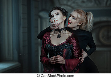 Blonde woman biting her neck like a vampire.