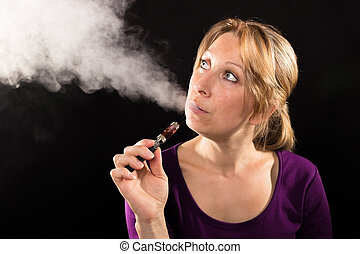 Woman vaping electronic cigarette - Woman enjoying e-cig