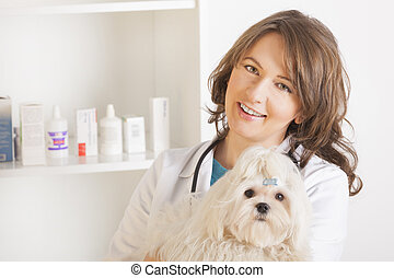 Woman vet holding a dog