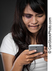Woman victim of domestic abuse sms