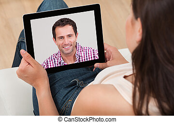 Woman Video Chatting With Man