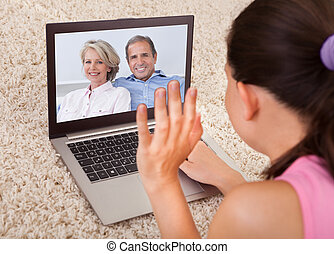Woman Video Chatting With Parents