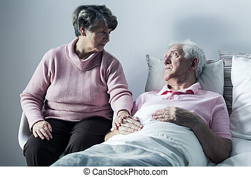 Woman visiting man at hospice