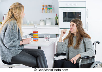 woman visiting the handicapped friend