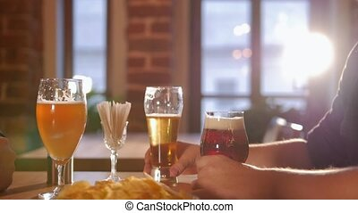 Woman waiter filled up the glass of beer and leave.