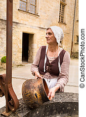 Woman waiting at medieval water well