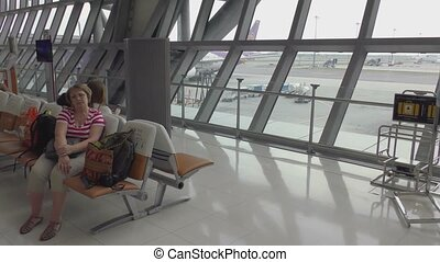 Woman waiting for the departure