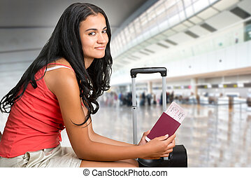 Woman waiting in an airport