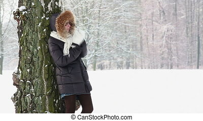 woman waiting in winter park