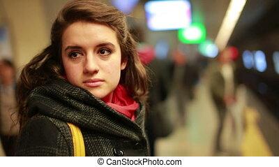 Woman waiting metro at station