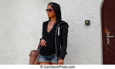 Woman waiting near home