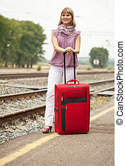 woman   waiting  train on  railroad
