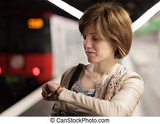 woman waiting train