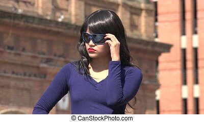 Woman Waiting Wearing Sunglasses And Wig