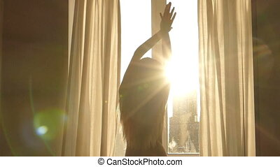 Woman wakes up, Silhouette of  woman against window