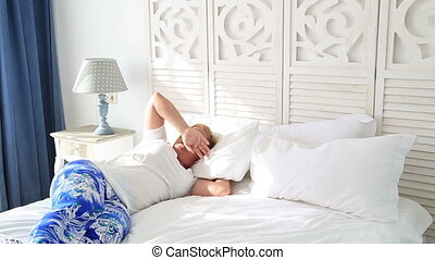 Woman waking up and yawning with a stretch