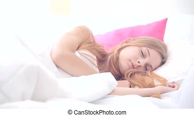Close-up of a pretty woman waking up video
