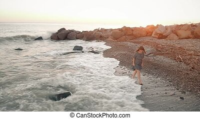 Woman walk at the beach at sunset - Happy woman in dress...