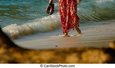 Woman walk on the beach