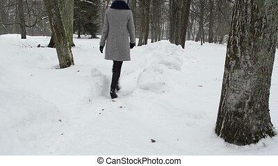 woman walk park path snow