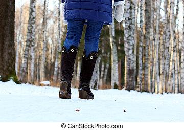 woman walk park winter snow back