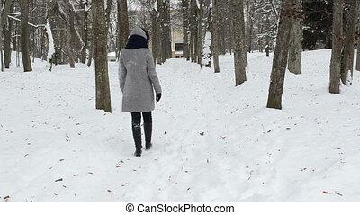 woman walk path snow