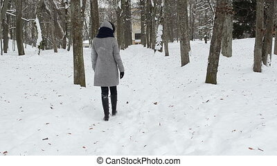 woman walk path snow