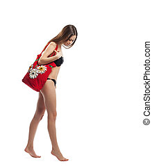 Woman walk with red beach bag isolated