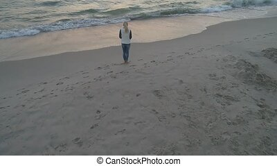 woman walking along the beach