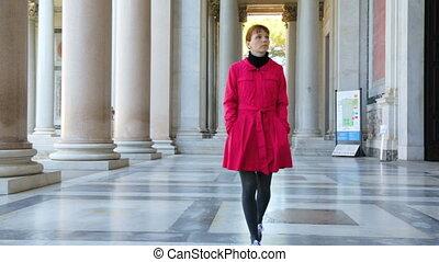 Woman walking along the columns in Basilica of Saint Paul