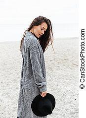 Woman walking and relaxing near sea