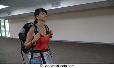 Woman walking at empty airport hallway