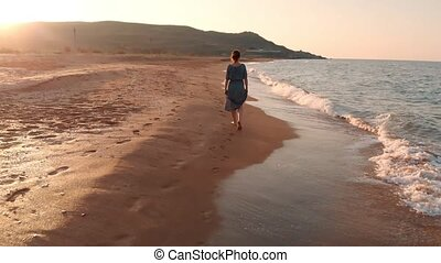 Woman walking at the beach