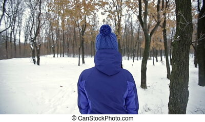 Woman walking at winter park