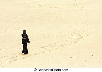 Woman walking by desert routes