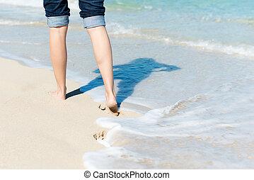 Woman Walking By Ocean