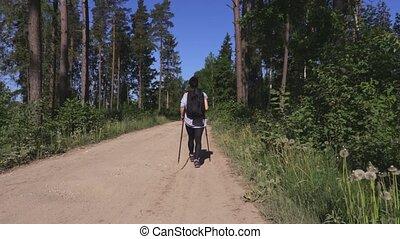 Woman walking cross country
