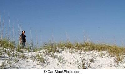 Woman Walking Down Dune