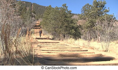 Woman walking down Manitou Incline