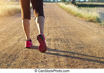 Woman walking exercise on trail in summer nature