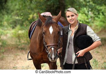 Woman walking horse