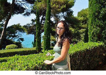 Woman walking in a botanical garden