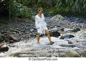 woman walking in a river