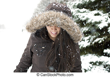 woman walking in a snow forest